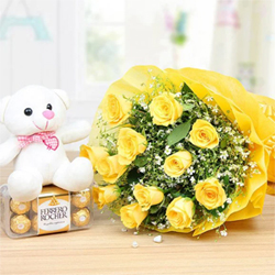 12 Yellow Rose bunch wrapped with a beautiful paper packing, 16 Pcs Ferrero Rocher and a 6
