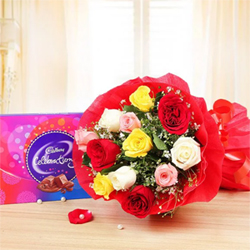 Paired perfectly, this imperfectly perfect bouquet of roses Twelve Mixed Roses One Cadbury Celebrations (131g)