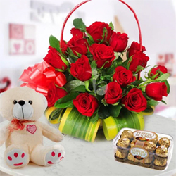 When 24 Red Roses come in a love basket along with a pack of 16 delicious Ferrero Rochers small teddy bear