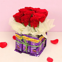 A Glass Vase 12 Dairy Milk Chocolates(each-13Gms) 10 Red Roses