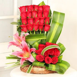 Arrangement of 30 Red Roses and 2 Pink Lilies in a Basket
