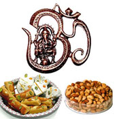 This hamper is a special treat for some special people. Shower your love through this exclusive gift hamper. This hamper contains a sweet thali of Kaju hearts (250g) and mewa roll (250g), a gunmetal made Om Ganesh wall Hanging and Assorted Dry Fruits 400 Gms. The assorted dry fruits include Almonds, Cashew nuts, Pistachios, and Raisins 100 gms each in a crystal clear plastic container. Let your dear ones in Gifts to India enjoy the delectable taste of the sweets and dry fruits, when Ganesha will shower His divine blessings on them.