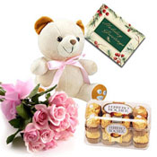 This elegant hamper contains bunch of 12 Pink roses,bunch  Cute Soft toy (6 inches) and a box of Ferrero Rocher(16 pcs) chocolates. The hamper also includes a Greeting Card.