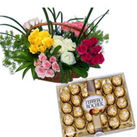 FERRERO ROCHER 24PC +  100 Mixed roses basket  in full bloom are beautifully arranged.