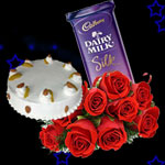 1/2kg Normal Pineapple Cake, rose bunch and Diary Milk Silk Medium Bar.(65 gms)