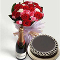 A bunch of 15 mixed roses with 1kg Chocolate/black forest cake and a Non alcoholic fruit juice bottle.