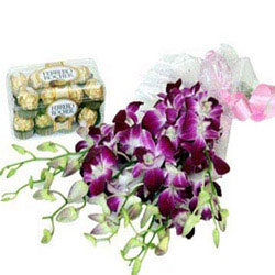 Bunch of 6 Purple Orchids in a cellophane packing with Purple Ribbon and 16pcs Ferrero Rocher chocolate box.