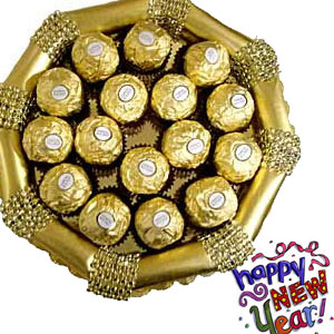 A wonderful handmade tray full of imported16pcs Ferrero Rocher chocolates. Chocolates in a crispy and crunchy hazelnut exterior are individually wrapped for that freshness.