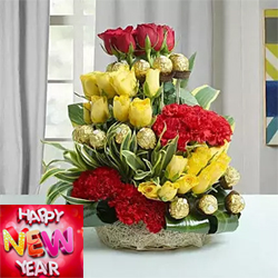 Arrangement of Ferrero Rocher Chocolates - 16 pcs., Red Roses - 6, Yellow Roses - 20, Red Carnations - 12 Draceane Leaves & Dry Sticks