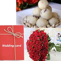 100 Red roses bunch + 1kg Ravva Laddu +New year card
