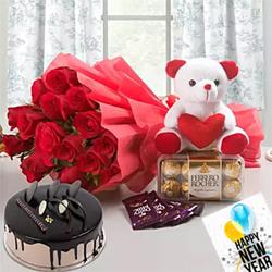 Bouquet of 15 Red Roses Cadbury Dairy Milk Chocolate - 5 (12.5 grams each) Teddy Bear - 6 inches Ferrero Rocher Chocolate Box - 16 pcs.500 grams Chocolate Cake -