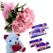 12pink roses bunch with 5 Cadbury almond chocolates Teddy bear 6 inches.