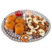 special Silver Rakhi Thali Combo. One Rakhi,  Motichor Ladoo in 250 grams and 100gm Almonds and 100gm Cashews.