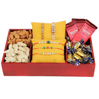 This Rakhi, give a grand surprise to your 5 brothers For Rakhi' Combo. It includes  3 Nestle Classic Chocolates of 18 grams each, 20 Cadbury Eclairs Almonds of 100 grams, Cashews of 100 grams and 5 Rakhis
