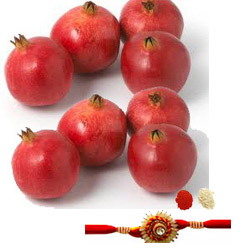 A basket of seasonal fresh pomegranates for your loved ones. 10 pieces Rakhi with roli chawal.