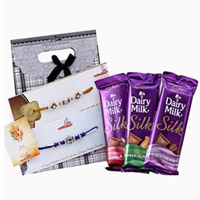 3 Cadbury Dairy Milk Silk in flavor of Fruit & Nut, Roast Almonds, Milk Chocolate  With 2 rakhi set