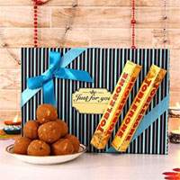 Present this gift hamper of tempting 250 gms Sunnundalu, and 2Each one 50gms Toblerone chocolates,Small Cadbury Celebration Gift Pack to your loved ones