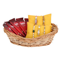 This combo comprises of One Brown Basket filled with Five Different Designer Rakhis with Free Roli Chawal and 5 Nestle Classic Chocolates of 18 grams each.