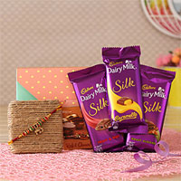 Special Celebration for your cool brother. Rakhi in colorful Beads Three units of Dairy Milk Silk chocolates each one 60gms