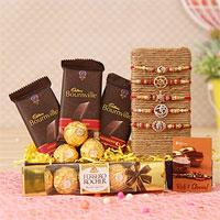Raksha Bandhan is a special affair not just for siblings but cousins too Divine Set Of 5 Om Ad Rakhi,Ferrero Rocher 5 Pcs Chocolate Box,Cadbury Bournville Cranberry