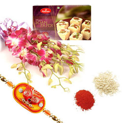 Orchids With Sweets, Bunch of 6 exotic blue or purple orchids, 1kg Soan Papdi with one Rakhi & Roli Chawal.