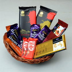brings for you the basket of joy, containing - 2 Pieces Cadbury Temptation Bar (72 gm each) + 2 Cadbury Dairy Milk Chocolate (18 gm each) + 2 Pieces Cadbury Roasted Almond (42 gm each) + 2 Pieces Kit Kat (18 gm Each) +2 Bournville (33 gm) + 2 Pieces Cadbury Temptation Bar (72 gm each) + Round Basket.