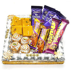 200 gms Kheerkadam, 200 gms Kesar Barfi, teamed with 4 bars of Cadbury Dairy Milk chocolates,2 Munch Chocolates & 2 Bars of Cadbury 5 Star chocolate