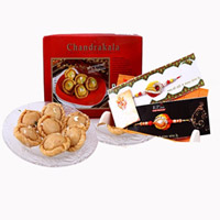 This hamper includes 1/2kg Chandrakala A combo set of two rakhis