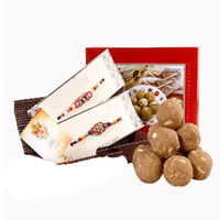 Sunnundalu : Very tasty sweets made of fresh ghee highly recommended for growing children. Qty - 1/2kg A combo set of two rakhis