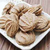 Delicious butter cookies that are irresistibly inviting RAKHI WITH COOKIES