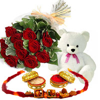 12 of the finest red roses are complemented by delicate gypsophila with small teddy Bear with  free rakhi