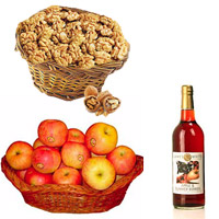 10 pcs Send these juicy, luscious Red Apples arranged nicely in a basket Non alcoholic fruit juice bottle.+ Basket filled with Fresh Walnuts. (Net Weight : 250 Gms).