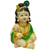 Lord Krishna or Bal Gopal as he was fondly called in his naughty childhood, is one of the most loved and adored Gods of Hindu religion. This is a special gifts for all the devotees of lord Krishna. A beautiful idol of Bal Gopal made of Fine stone dust with artistic decorations on it. Height: 6