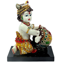 Bal Gopal is sitting and eating makhan form the pot. This is Hand Carved Baby Krishna Resin Idol <br>lead time 2 working days