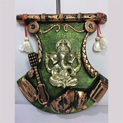 Ganesh with musical instruments wall frame   height : 12 inch , widht :8 inch <br> Material:- Plastic <br> Color:- antique and green <br> delivery time : 2 working days