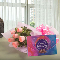 6 Pink Roses Pink Packing Paper Pink Ribbon 131.3 grams Cadbury celebration box