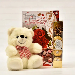 gift this romantic combo to your girlfriend. The combo contains one Sweetheart greeting card, one small teddy bear and 4 Pieces of Ferrero Rocher Chocolates.
