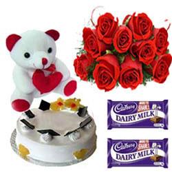 10 Red roses bunch 1/2 kg vanilla Normal cake small teddy 2Cadbury Dairy Milk.Chocolates