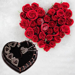 a perfect heart shaped bouquet of 35 red roses and a delicious 1 kg. chocolate heart shape  cake..