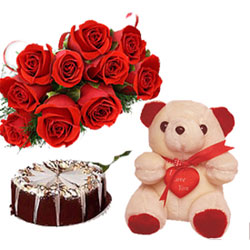 12 Red Roses Bunch, 1/2kg Normal Chocolate Cake and Small n Cute Teddy Bear.