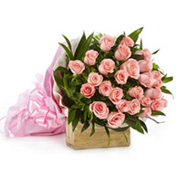 A delicately wrapped, hand-bunch of 30 gorgeous pink Roses with green leaf and knot it with pink lace make it perfect., Flowers to Bangalore