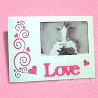 Buy this decent white and pink photoframe which itself says is full of love. Ideal for 4