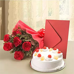 A bunch of 10 red roses in a red paper packing paper with a red ribbon bow, 500 gm Pineappale cake teamed up with a greeting card as per occasion