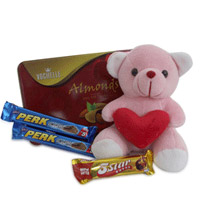 180 gms Vochelle almonds chocolate box, 2 perk of 15 gms each, 26 gms 5star and 6 inch long teddy bear.