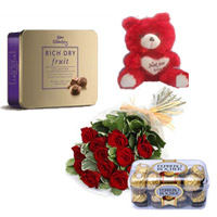 Bunch of 12 Red Roses & 16 Pcs Ferrero Rocher Delicious Cadbury celebrations Cashew Weight 175gr & small teddy bear 6inch height.
