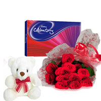 Bunch of 12 Red Roses in cellophane Packing with red ribbon bow and box of 126gms cadbury celebration chocolate  small teddy