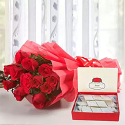 A bunch of 12 beautiful red roses packed in a brusque paper with a red ribbon  500 gm Kaju Katli box is also included to celebrate the occasion with sweetness