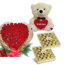 A cute Teddy of height 16 inch 100 Red roses heart shape basket <br> 48 pcs ferrero rocher chocolates <br>  (color & design of teddy may vary as per availability)