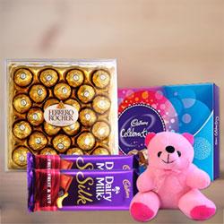 Ferrero rocher 24pcs box, Celebrations Pack, Cadbury silk medium 2 , Teddy bear 6 inch <br> Order this beautiful gift hamper