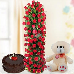 This magnificent combo consists of an exceptionally tall arrangement of red roses An arrangement of 150 red roses - 1 Kg chocolate cake - 12